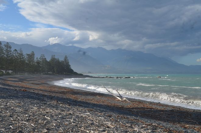 The stony and black sand beach of Kaikoura