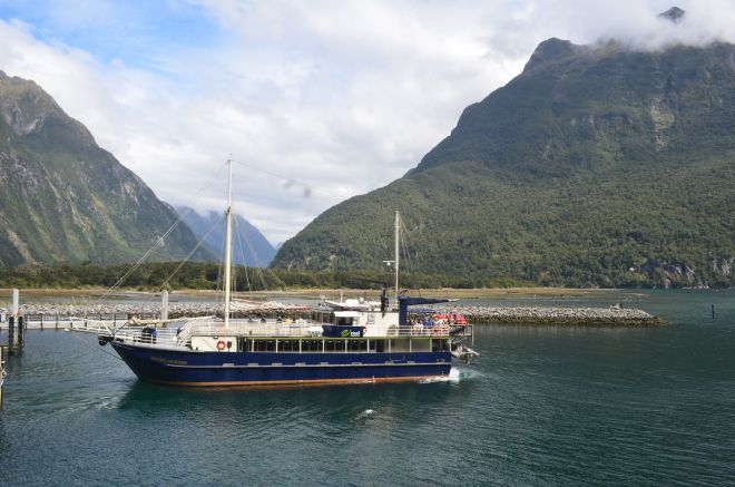 View of Milford Sound from our boat and photo of another cruise boat with the Sound in the background