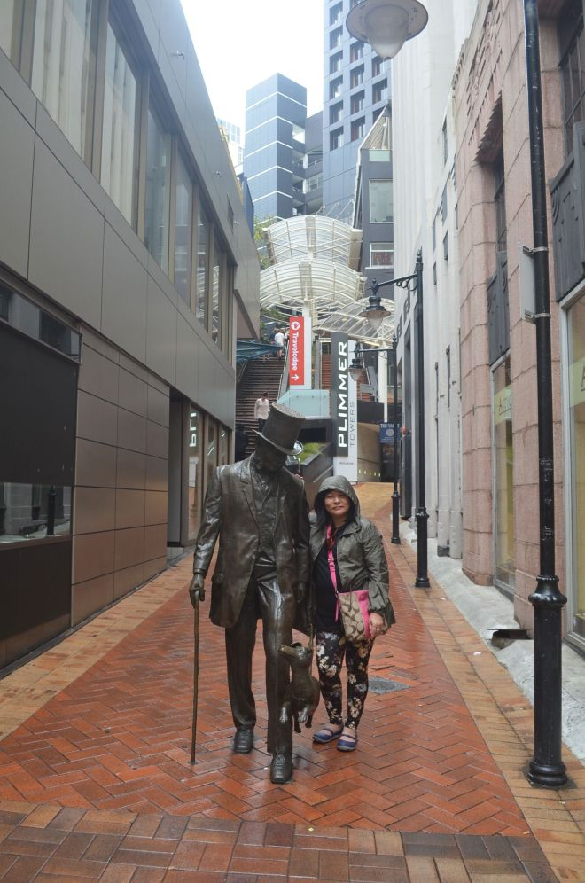 Victoria Street, empty on a Sunday evening and Statue at Plimer's Lane
